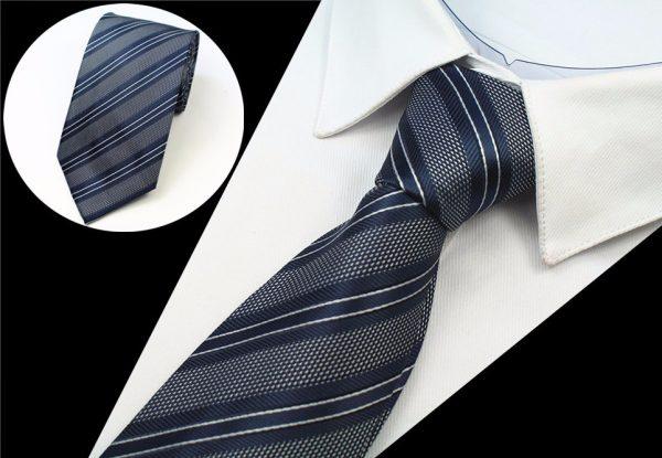 Spoločenská pánska kravata so vzorom v sivo - modrej farbe