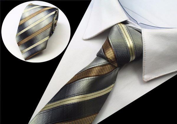 Kvalitná pánska kravata s pásikmi v zlato - sivej farbe
